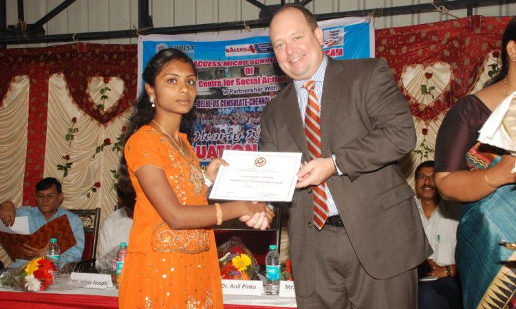 man presenting certificate