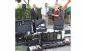 Group of people with various types of equipment. (Photo Credit: State Department)