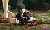 Two men sitting in a garden, talking. (Official White House Photo by Pete Souza)
