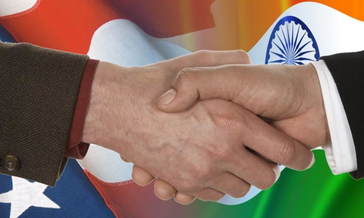 U.S. India flags hand shake